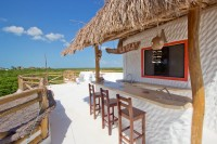 The bar and patio area included with the Palapita del Amor room.