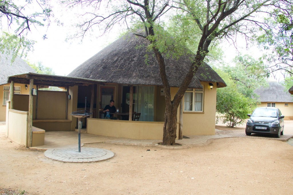 A chalet in Satara Camp and our tiny rental car.