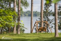 Relax in front of your cabin on a swing overlooking the lake