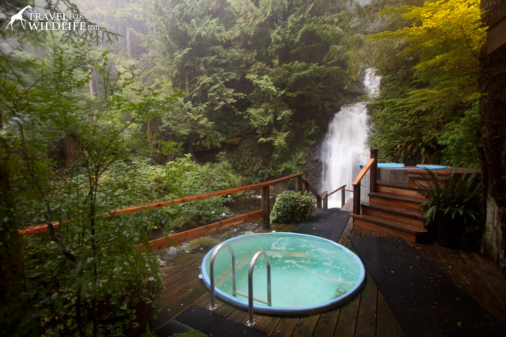 Outdoor hot tub by a waterfall