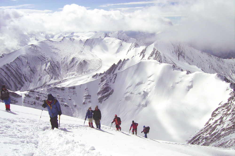 a group of hikers in the mountains of northern India