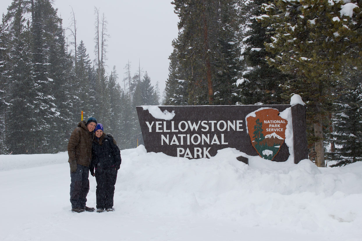 Us posing in front of the Yellowstone sign in the snow