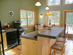 a view of the kitchen area in the cabin in the woods