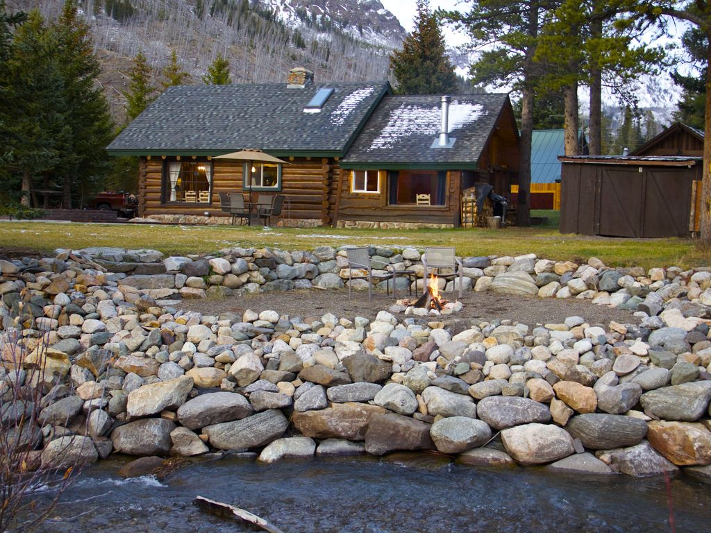 A log cabin by the creek