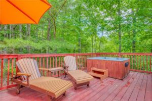Cabin deck with hot tub included