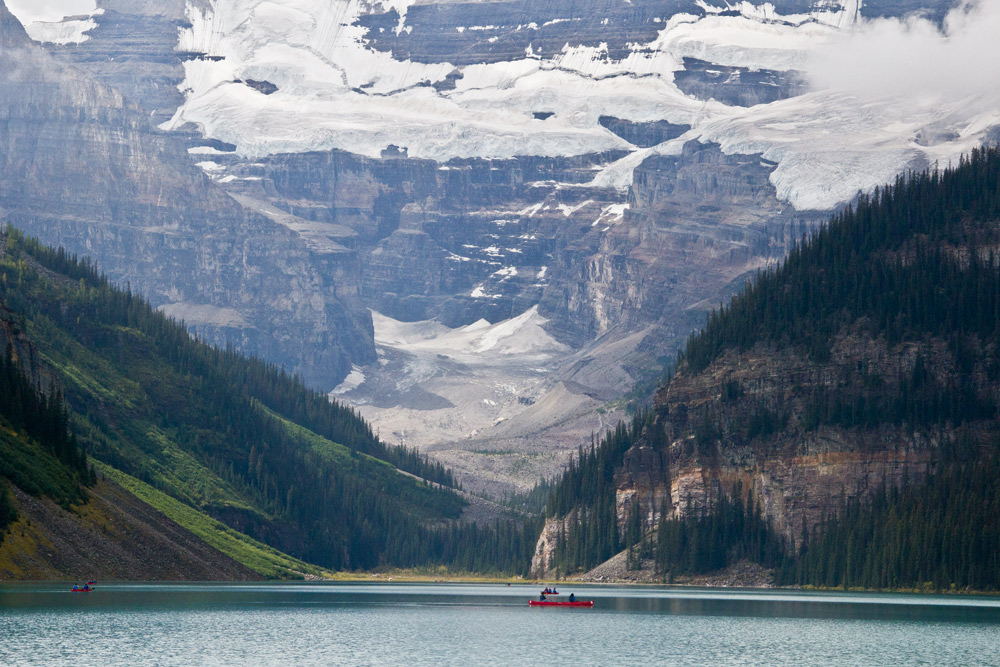 Canoe by glaciers at Lake Louise